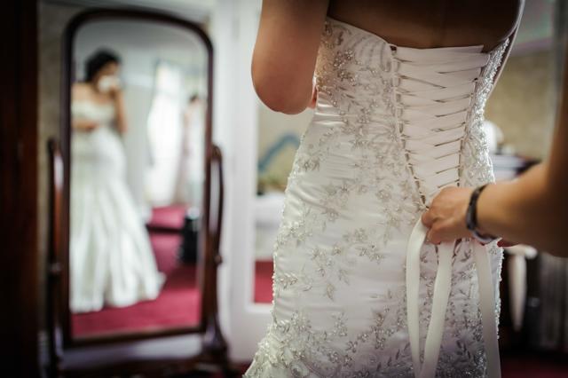 tying up wedding dress