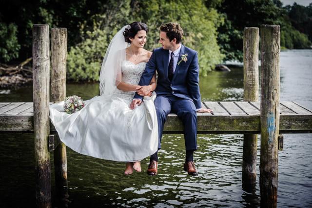 bride groom sat on jetty
