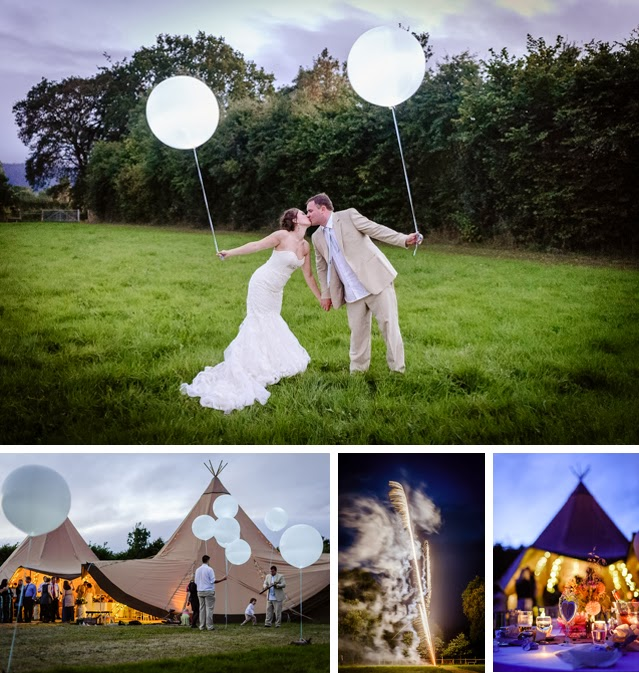 giant white wedding balloons at evening wedding reception in field