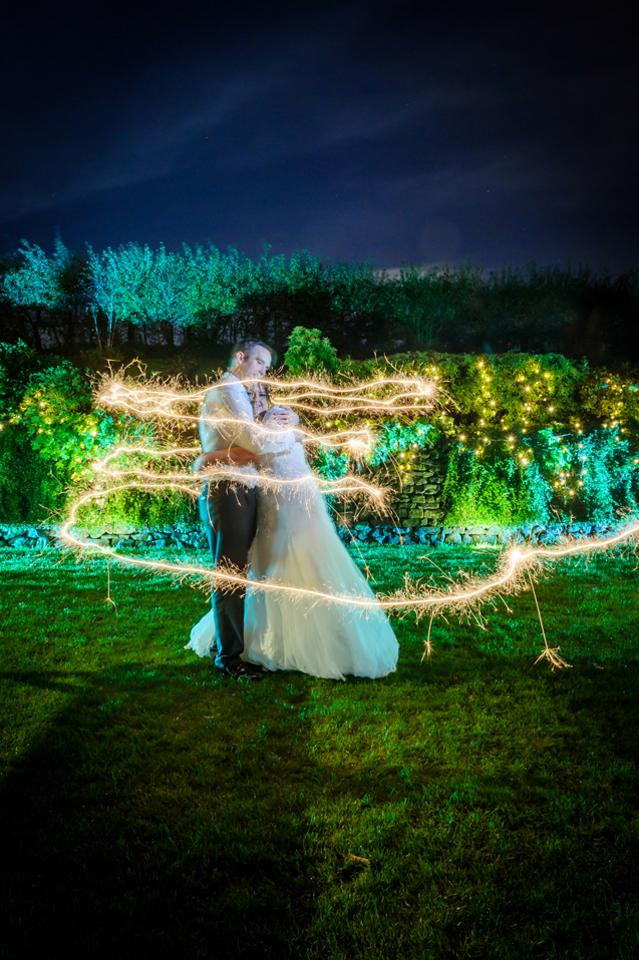 bride groom hug with sparkler