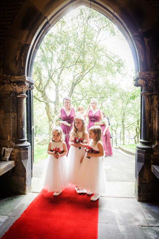 bridesmaids waiting to enter church