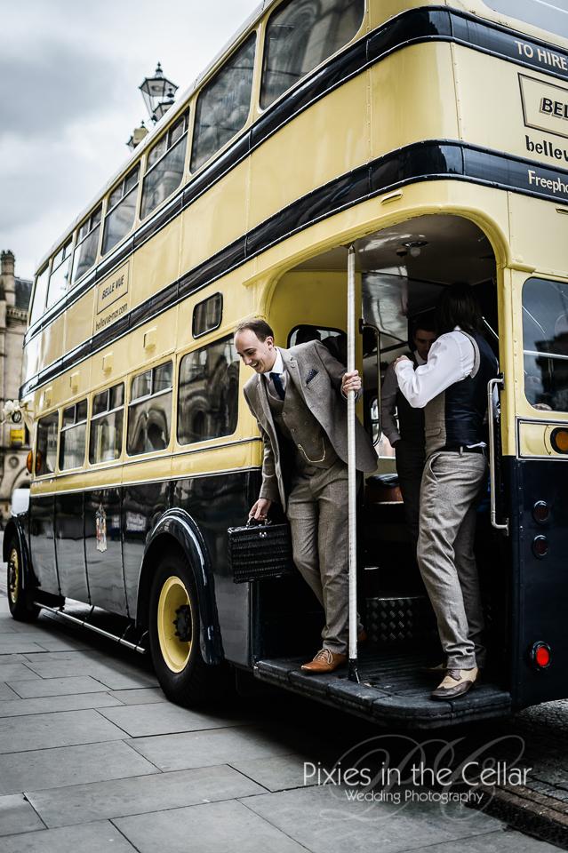 groom arrives on bus manchester wedding
