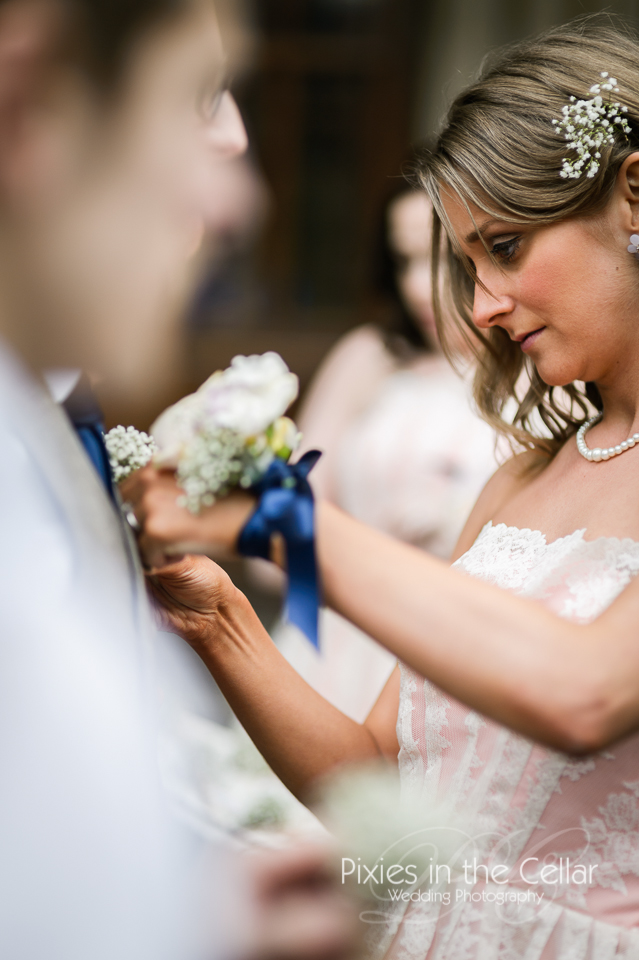bridesmaid doing button holes