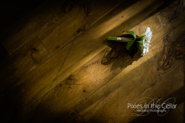 bridal bouquet on floor in sunlight