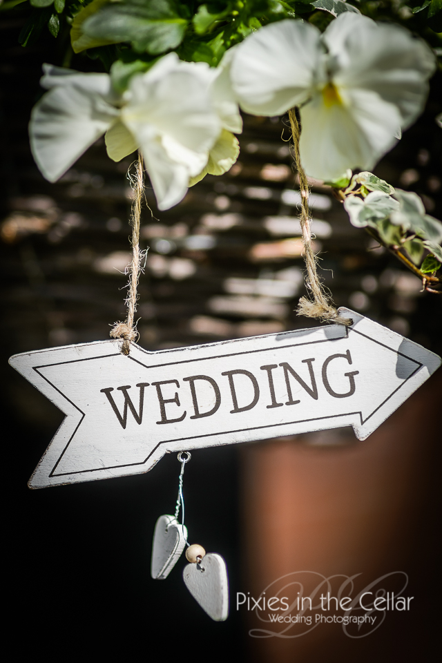 wedding sign on hanging basket