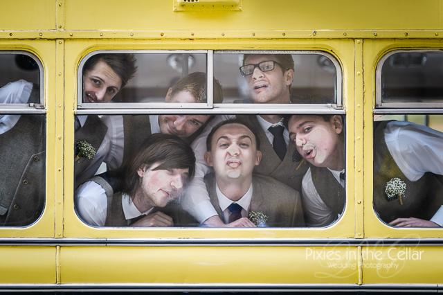 Groomsmen at bus window