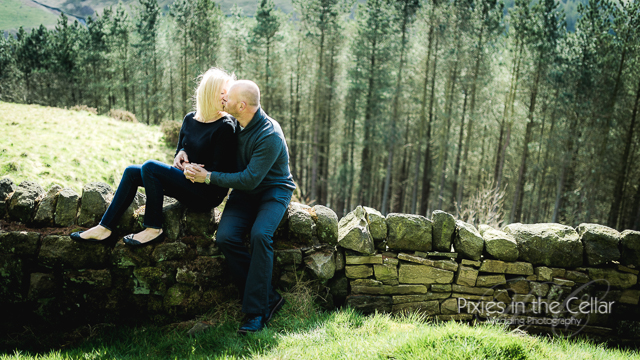 kissing sat on wall in countryside
