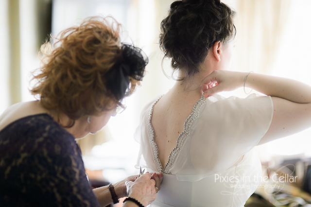 bride and mum final wedding dress alterations