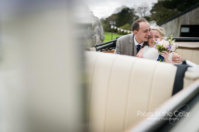 bride groom in wedding car