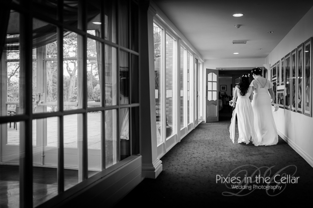 two brides walking in corridor