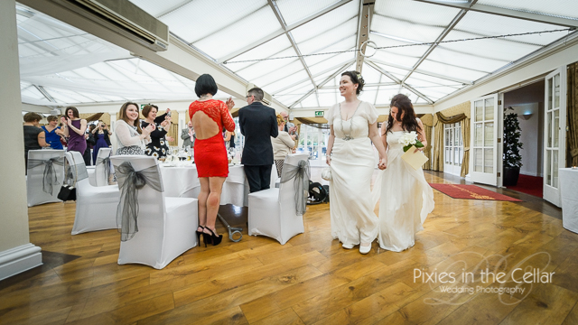 two brides enter wedding reception Mere court Hotel