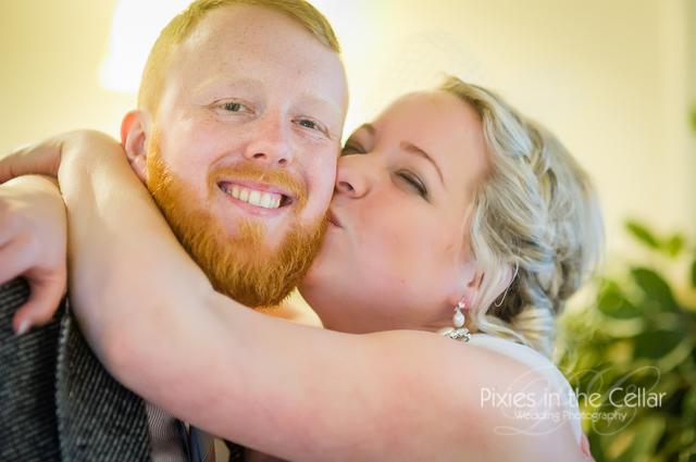 bride kissing ginger beard man