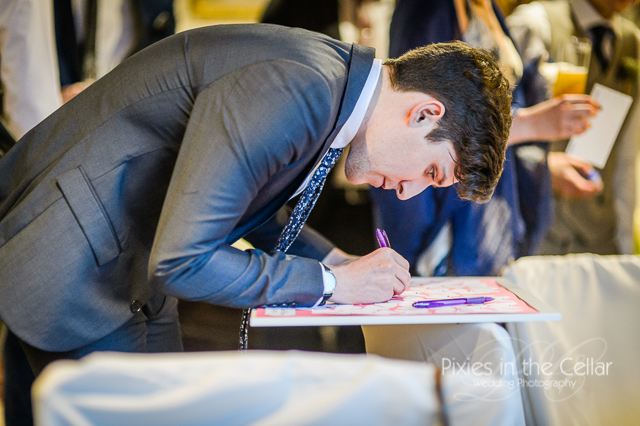 signing guest book