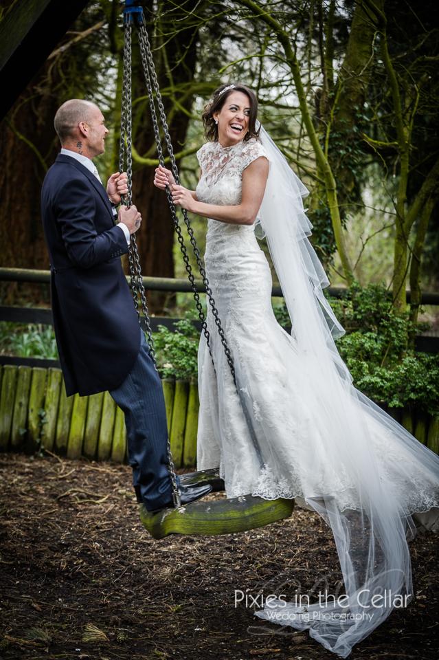 bride and groom on tyre swing