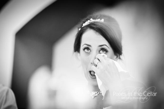 bride wiping tears