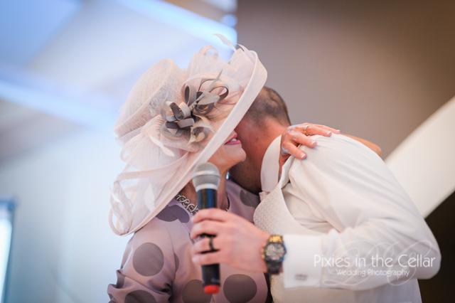 wedding hug with big hat