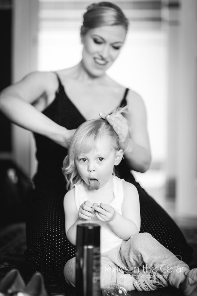 mum doing daughters hair