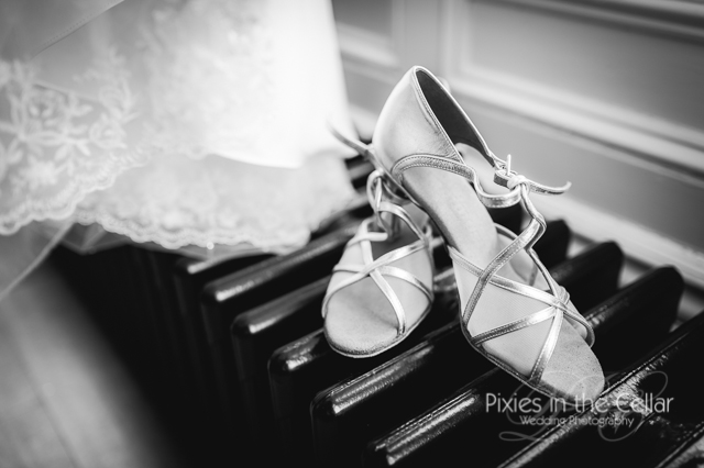 strappy wedding shoes on radiator