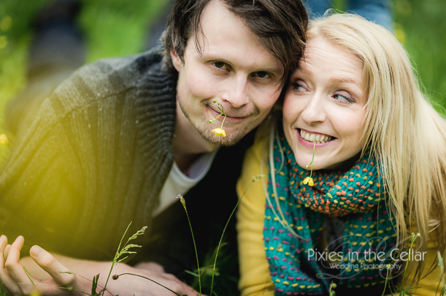 couple with buttercups in mouths