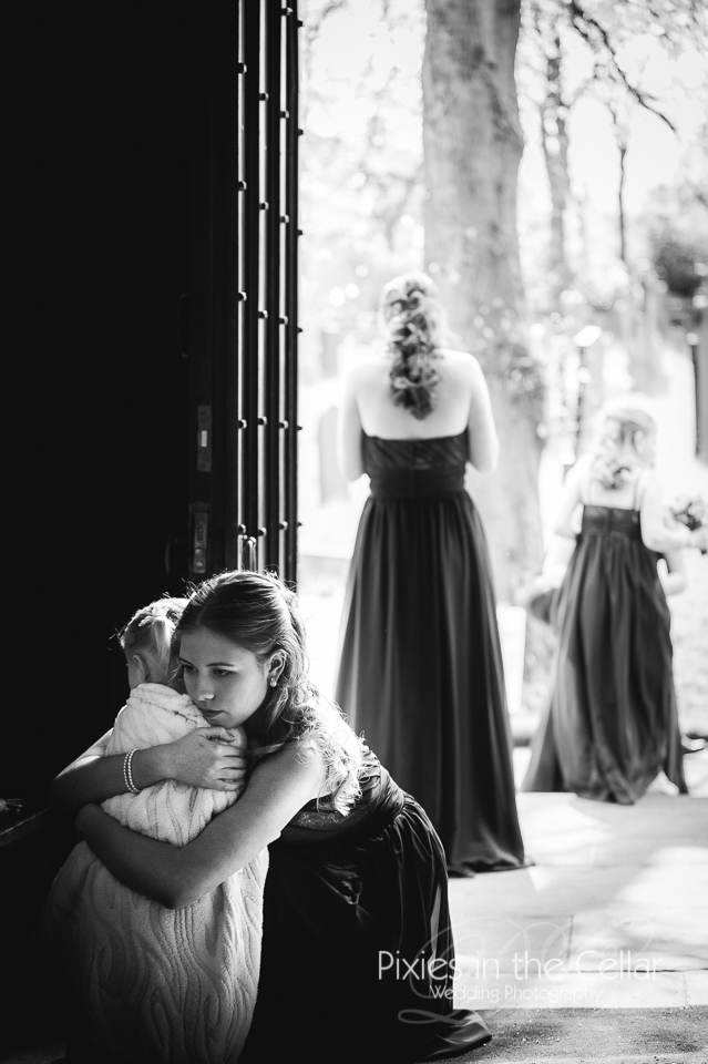 bridesmaid hugs flowergirl