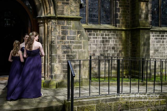 purple bridesmaids waiting at church