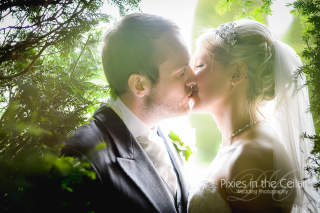 bride groom kissing