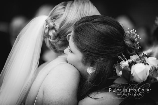 bride hugs bridesmaid
