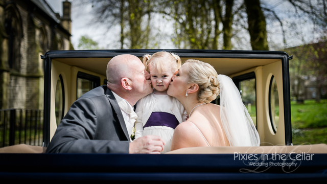 bride groom and daughter in car