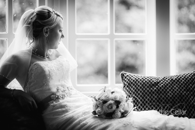 bride in window black and white