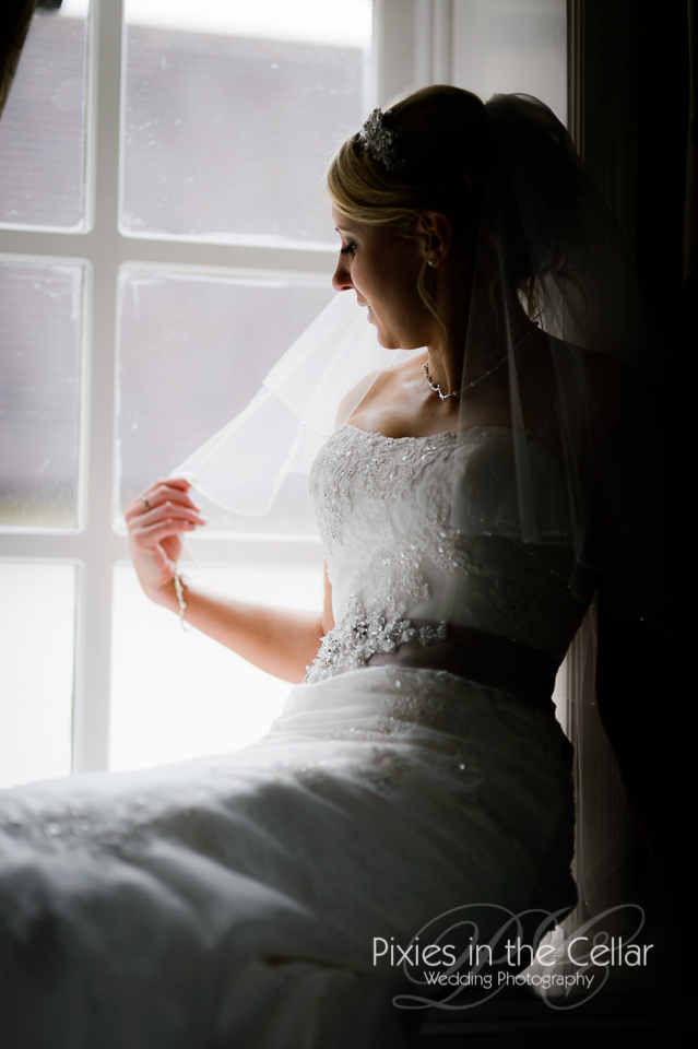 bride sat in window