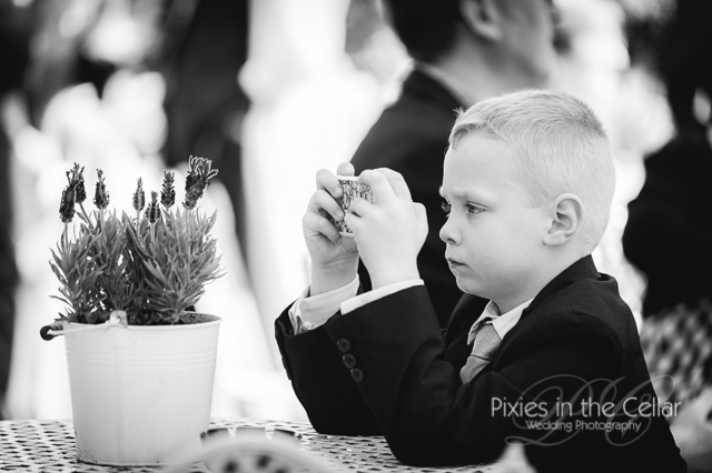 boy on phone at wedding
