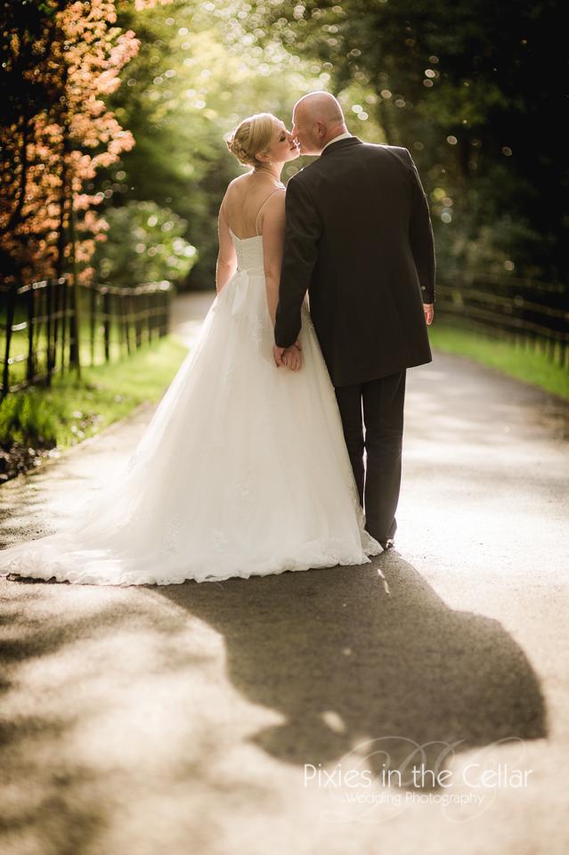 wedding walking down lane in evening light