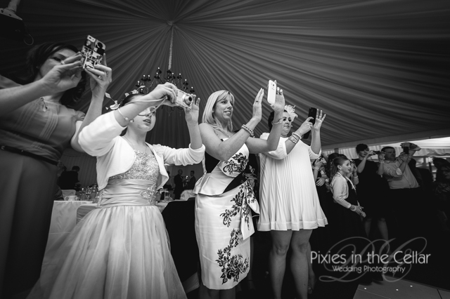 wedding guests photographing first dance