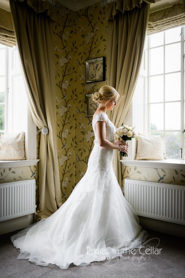 Bride in window Manchester wedding photographer