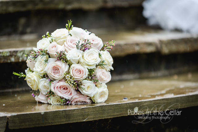 Pink and cream roses wedding bouquet with Rosemary