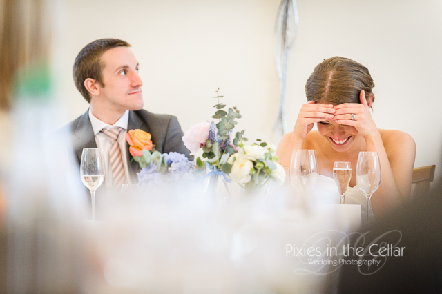 bride hiding face during speeches