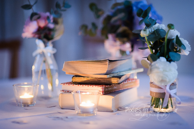 wedding details vintage books and jam jars