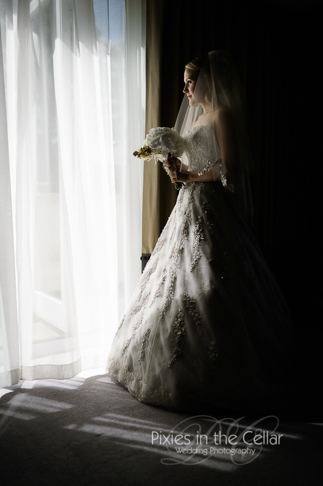 Rudding Park hotel Wedding photography bride at window