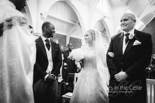 dad bride and groom in church