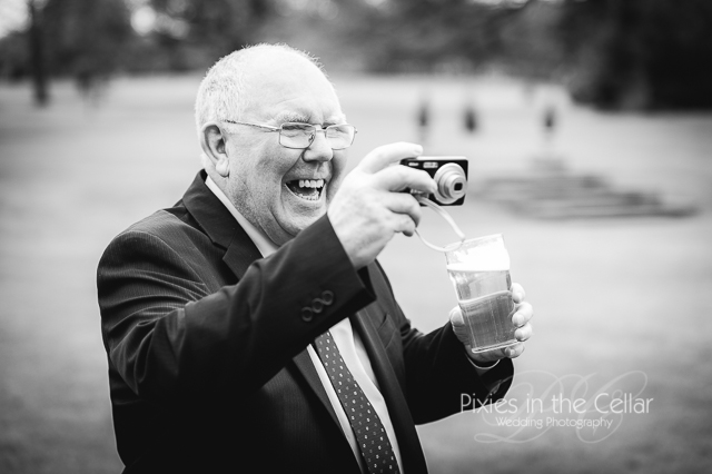 Man with beer and camera