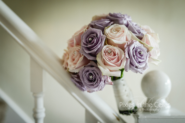 dusty purple and pink roses wedding bouquet