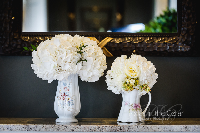 white flowers in floral vases