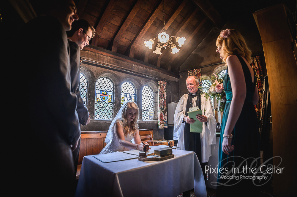 signing register wedding in old cheshire church