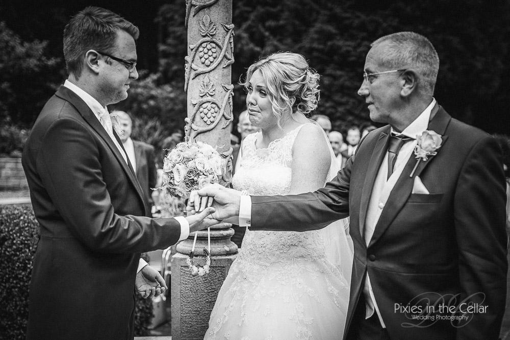 Emotional bride outdoor ceremony