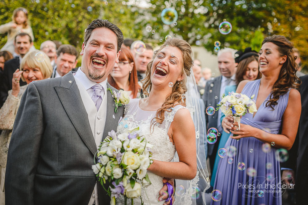 Laughing wedding bubbles yorkshire