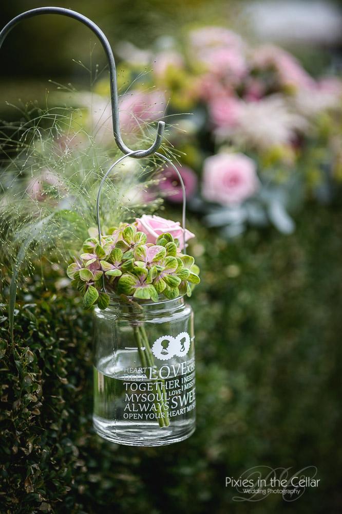 outdoor jam jar wedding detail pink