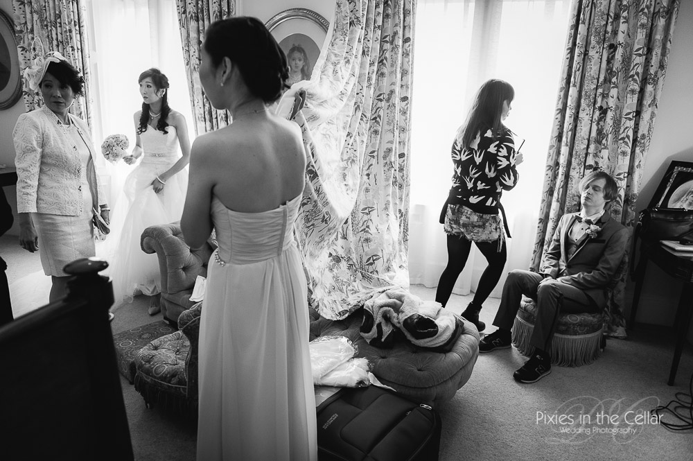 bride and groom getting ready capesthorne hall