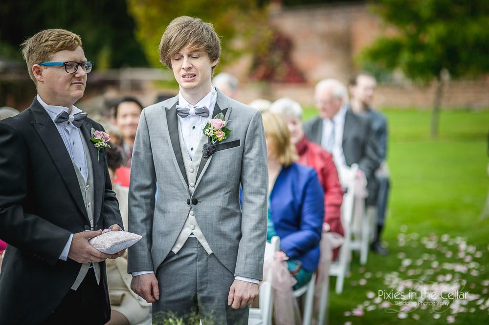 groom waiting outdoor ceremony