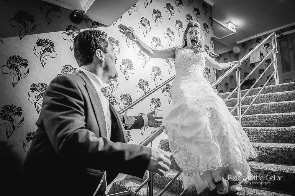 bride sliding down bannister