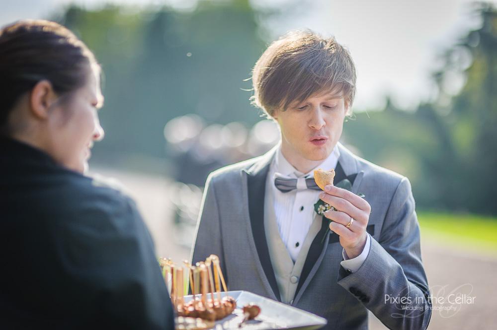 groom with canapés